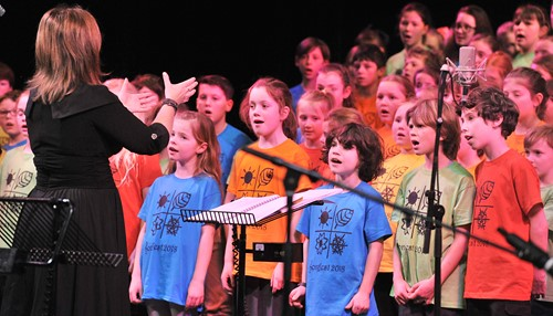 Children singing at a Songfest concert