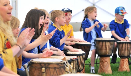Children with djembe drums