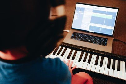 Picture of child with keyboard and laptop